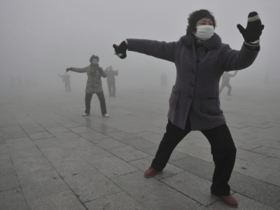 Morning Tai Chi in China with dense, deadly air pollution